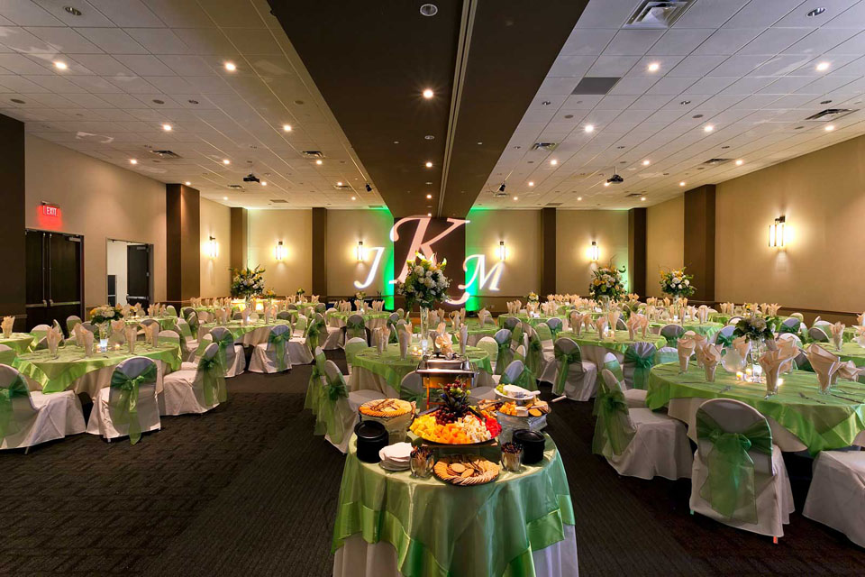Green and White Room setup with Table Overlays, chair covers and ties , Wedding at the Red Oak Ballroom in Austin