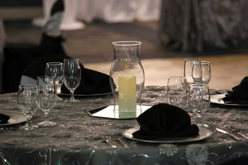 Social Celebration setup with charge plates and textured table overlay