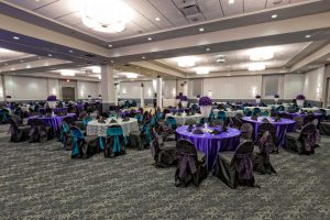 Red Oak Ballroom in San Antonio, chair covers with ties, plate chargers with preset salads