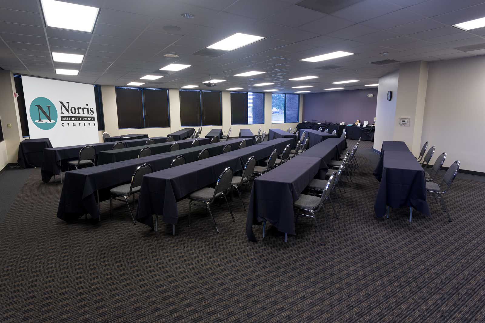 Meeting at Norris Centers Houston/Westchase, set classroom style with ergonomic chairs